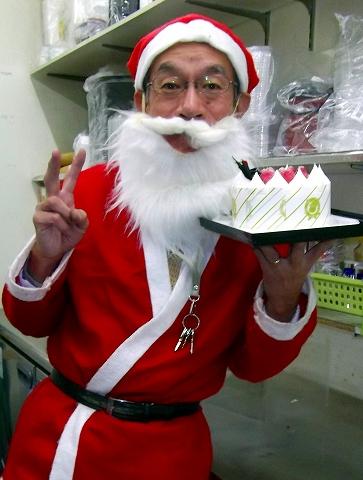 s-クリスマス・ケーキを手にしたサンタの爺さん.jpg